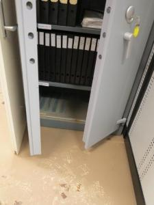 Cabinet affected by water damage in collection store.