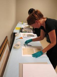 Dr Jo Wills placing items on blotting paper.