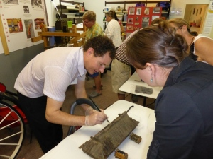 Adam Godijn, Senior Paintings Conservator at ICS, demonstrates during a timber conservation workshop held at the Cairns and District Chinese Association Inc.