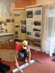 Jo Wills installing the exhibition in Seisa Holiday Park.