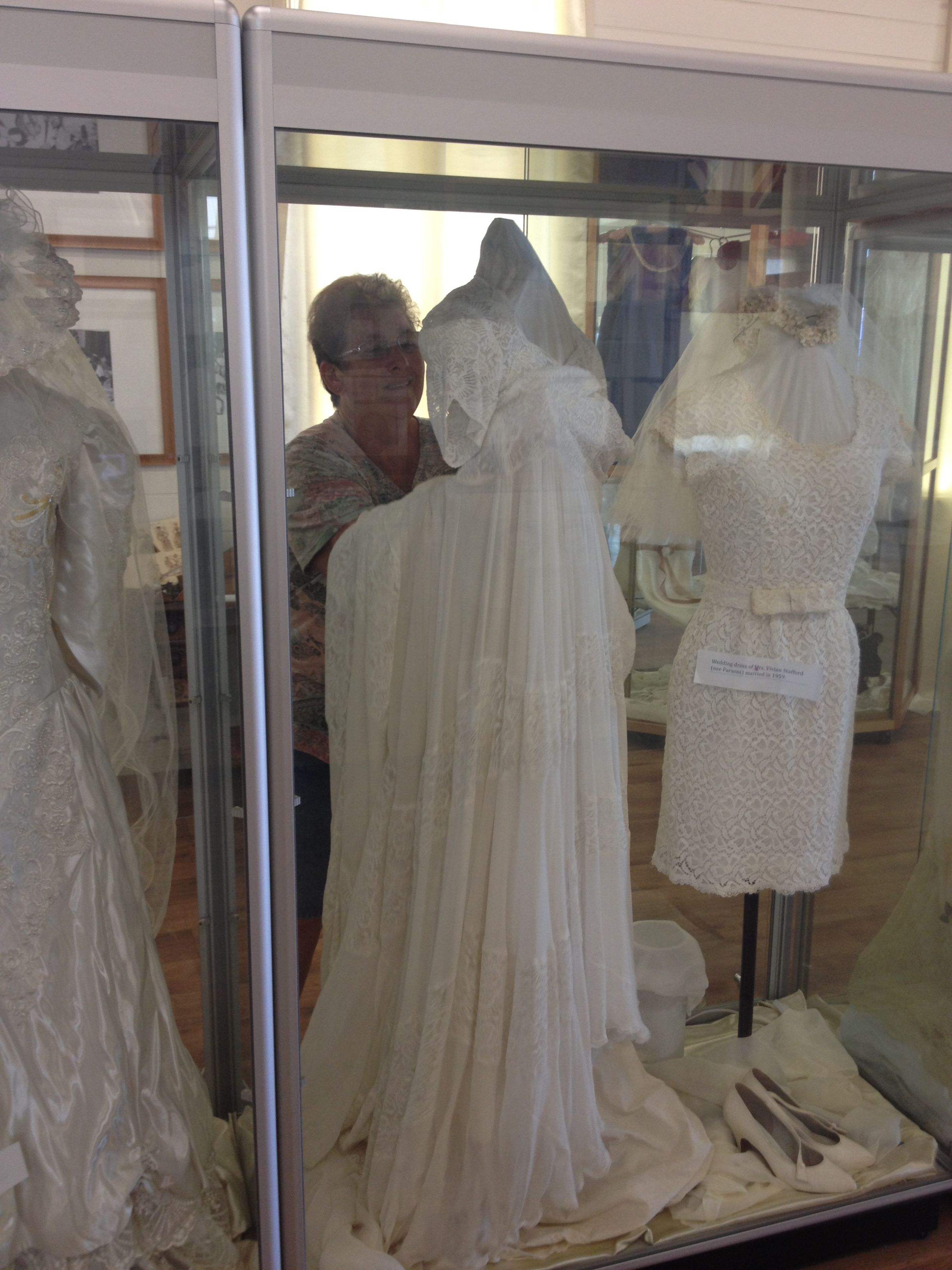 Stephanie Berger arranging the 1947 wedding dress worn by Mrs Von Brennan, married in Brisbane and costing 100 pounds.
