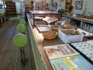 Folding stools and the beautiful broad planks of the haberdashery counter at Corfield & Fitzmaurice Store, Winton.