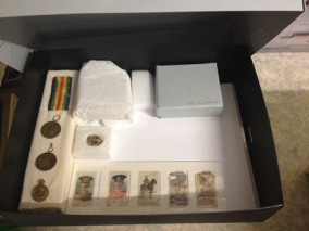 Conserved artefacts stored in archival box.