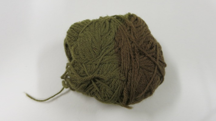 Detail of the ball of wool showing most fading.