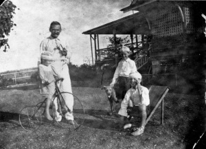 Albert Cook and his children Thomas, John and Althea, Christmas 1920.  The tricycle seen in the photo is still at the homestead.