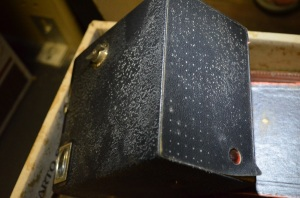 Box brownie camera with active mould affecting leather surface.