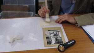 Photograph workshop- - surface cleaning the back of photograph. (Image courtesy of Karen Barrett)