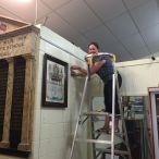 Melanie installing and adjusting hanging system