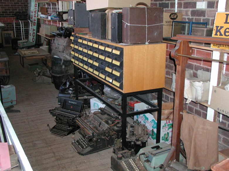 Typical typewriter breeding habitat. Note the typewriters lurking under the card index accompanied by their close relative, the adding machine
