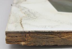 Water damaged window mat and strawboard backing board.