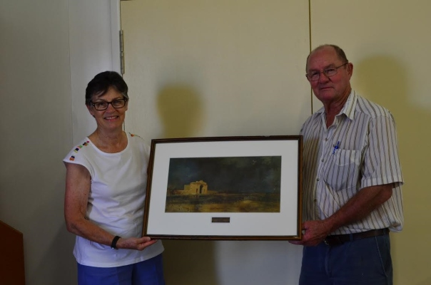 Helen and Bruce Collins of Winton and District Historical Society receiving the conserved print on behalf of the lender.