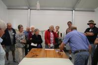 Visitors learning about the recovery and restoration of objects from the fire