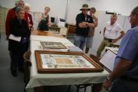 Visitors viewing objects after conservation