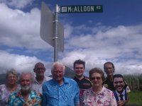 McAlloon family descendants photographed at their street sign in Gordonvale. Image: Pyramid News.