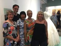 Cairns Museum volunteers used their sewing prowess to dress the mannequins, here with exhibition designer, Michael Marzik. Image: Suzanne Gibson.