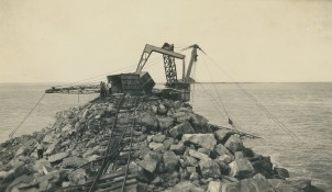 Damage to the Telpher crane and breakwall following a cyclone in early 1938. NQBP Collection