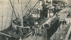 The first shipment of sugar is loaded on to MV Mundulla, Septmeber 1939. NQBP Collection