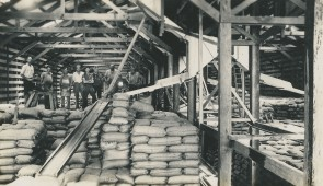Bagged sugar awaiting loading in the sugar storage shed at the harbour, c. 1939. NQBP Collection