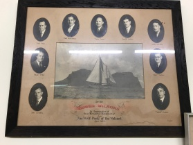 'Valiant' visited the island in April 1934 and presented this framed photograph of the yacht and her crew to Gower Wilson